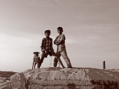 Boys and Dog - Sepia (Sharanya Manivannan) Tags: boy people dog india beach boys sepia children sand afternoon madras indians chennai thalankuppam