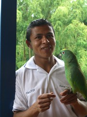 Hector our servant boy and Puchuru the talking parrot - he is wild but hangs around, Finca Los Grisoles, Coffeelands Colombia