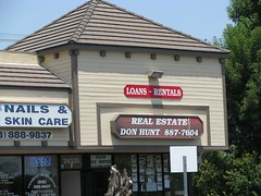 loan emporium sign