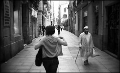 Encounters. (flevia) Tags: barcelona street bw sunlight streets film