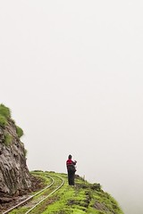 Journey to the End of the World (Tilak Haria) Tags: india mist green rain fog journey valley rails maharashtra mumbai matheran blindcurve aplusphoto