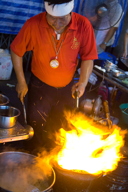 Frying up noodles over hot coals, Bangkok's Chinatown