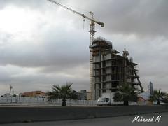 Nakheel Tower u/c - Riyad (-Mohamed-) Tags: city sky urban tower glass skyscraper al noir cloudy kingdom ciel saudi arabia nuage riyadh moder riyad nuageux urbanisation nakheel arabie anoud saoudite