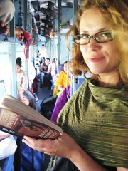 Standing in the aisle on the train to Sawai Madhopur, India