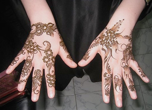 Henna tattooed hands.