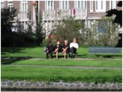 homeless man and business people sitting on bench (erinhazel) Tags: 2005 netherlands amsterdam august