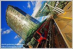 London City Docklands - Train Lines (david gutierrez [ www.davidgutierrez.co.uk ]) Tags: road street city trip travel blue light vacation sky urban holiday color building london tower art tourism glass lamp colors lines architecture modern composition train buildings wonderful point geotagged photography photo fantastic europe cityscape colours view angle image artistic weekend gorgeous sony awesome centre capital perspective picture cities cityscapes officebuilding wideangle pic center structure architectural future stunning excellent docklands metropolis unusual lovely alpha fabulous avenue dlr londoncity londontransport municipality edifice vibrancy 1118mm flickrsbest sony350dslra350