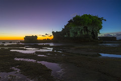 Last Light at Tanah lot (Goesena) Tags: sunset bali cloud sun tree tourism water rock indonesia twilight nikon tour cloudy guide tanahlot d7000