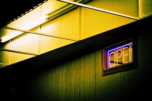 Come On In - a neon 'open' sign in the window of the Red Apple Restaurant in Stayton Oregon