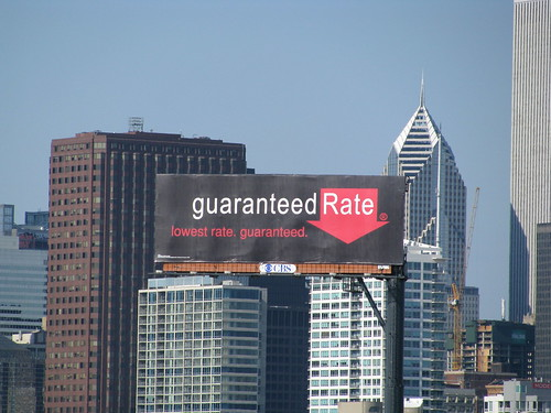 a sign promoting mortgage refinancing