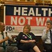 Rep. John Conyers, Donna Smith, & Norman Solomon talking about Healthcare not Warfare at the DNC
