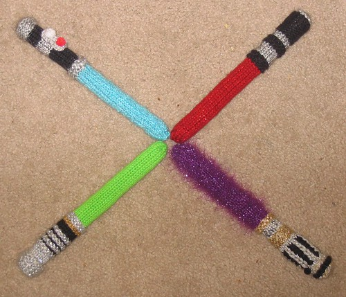 Oh cmon now people, seriously!?  They are LIGHT SABERS!  (yeah, Im giggling cuz Im apparently 12)