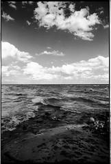Natural diptych. (flevia) Tags: sea sky bw clouds analog balticsea bn latvia nophotoshop seafront biancoenero lv baltics redfilter nikonfa lettonia ilfordfp4 pellicola kolka incrocio analogico scannednegatives sigma24mmf28 naturaldiptych thebaltics autaut epsonperfectionv700photo filtrorosso flevia rigagulf idontexactlyknowwhereiwas northskyisbigger ilcieloanordèpiùalto idontknowexactlywhereiam cielodenso crossingseas marichesiscontrano
