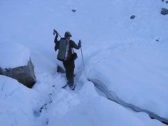 David crossing to old snow that remains under the new
