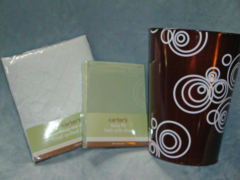 Carter's Mattress Pad, Knit Crib Sheet and trash can from Kristie and Debbie Miner