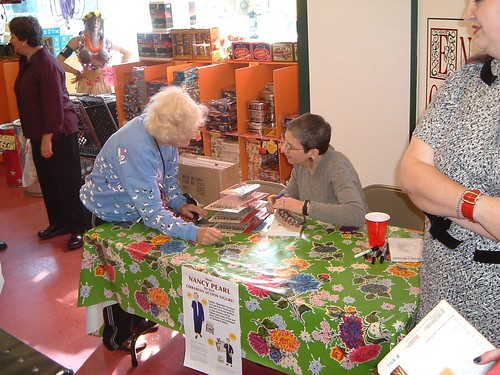 Nancy Pearl Signing her Action Figure at Archie McPhee, September 2003