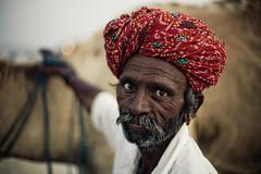 IMG_9545 Camel herdsman (Swiatoslaw Wojtkowiak) Tags: travel portrait india male canon beard asia desert market fair moustache camel 5d turban indien rajasthan inde mela herder    tilwara