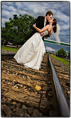 Didn't Your Parents Tell You Not to Play on the Tracks? (Ryan Brenizer) Tags: wedding storm love clouds groom bride leaf nikon kiss flash traintracks formal may iowa davenport 2008 d3 sb800 strobist dayaftersession chelseaandgarrett