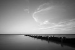 Out of sight, Out of mind (Myles Smith) Tags: sea sky bw white seascape black wall clouds still pipe direction sewage pollution outfall headspace kingofthehissyfit