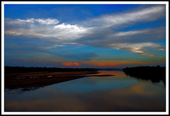Good Evening (Tipu Kibria~~BUSY~~) Tags: blue sunset red sky nature water clouds canon river dark eos evening colours fabulous bangladesh netrokona xti canon1785mmisusm 400d aplusphoto excapture birishiri flickrestrellas qualitypixels shomeshawri