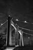 Hennepin Avenue Bridge Tower [Black and White] (mclain5798) Tags: city bridge urban blackandwhite bw water minnesota architecture modern night river evening downtown suspension minneapolis noflash mississippiriver twincities nikkor stanthony nicolletisland 18200mm nikond90