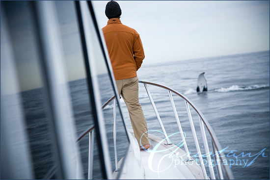Ryan Birtcher looking at a humpback whale near our boat by ChristanP Photography