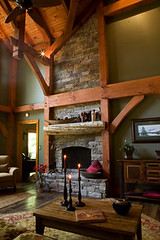 goshen_timber_frames_great_room_with_floor_to_ceiling_fireplace