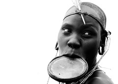 Mursi woman with lip plate , Omo valley Ethiopia (Eric Lafforgue) Tags: africa portrait woman girl artistic dam tribal lips ornament clay tribes afrika lip bodypainting ethiopia tribe ethnic onwhite rite barrage mursi bodymodification tribo indigenous labret headdress adornment pigments headwear headgear indigenouspeople omo eastafrica thiopien etiopia ethiopie etiopa coiffe 3817 tribalgirl  etiopija ethiopi  lipplug lipplate etiopien etipia  etiyopya  nomadicpeople lipplates   tribalgirls    salinicostruttori    gibeiiidam gibe3dam bienvenuedansmatribu peoplesoftheomovalley lipdisclipplate piercedhole piercedlipornament