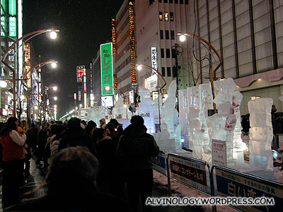 Lots of people gawking at the ice sculptures