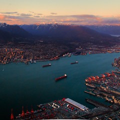 Sunset Over Vancouver Harbor (ecstaticist) Tags: ocean city blue sea sky urban cloud mountain snow canada building water architecture vancouver skyscraper photoshop canon square grid harbor town dock ship bc pacific harbour north grouse columbia aerial helicopter cap planning shore british coal shipping capped hdr dockyard hirise northvan photomatix tonemapped tonemapping g10 pseudohdr