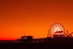 Santa Monica sunset (Andy Kennelly) Tags: california sunset sky orange sun beach wheel architecture night lights pier losangeles sand glow shot pacific santamonica ferris 100thbirthday kennelly ajax8055