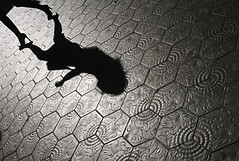 She's going that-a-way... (Trapac) Tags: barcelona light shadow woman silhouette shopping walking spring spain nikon shoes highheels pavement patterns catalonia diagonal espana sidewalk tiles paving heels catalunya handbag lightshadow killerheels passeigdegracia striding nikkor3570mm d700 nikond700 summertimeuk