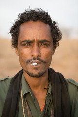 Meet The Janjaweed-05.jpg (Andrew Carter) Tags: fighter cigarette sudan smoking arab conflict militia darfur janjaweed unreportedworld