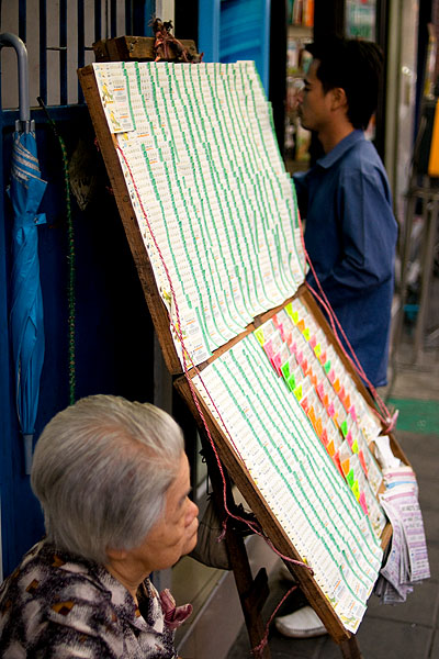 Selling lottery tickets in Bangkok's Chinatown