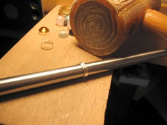 Enlarging on a bezel mandrel, with rawhide hammer.