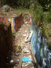 Graffitied Russian WWI trench (hugovk) Tags: summer abandoned june suomi finland geotagged concrete graffiti helsinki war mess wwi ab trench worldwarone ww1 helsingfors fortification hvk russian 1915 2008 fortress remains base firstworldwar sveaborg worldwar1 kes asema uusimaa krepost keskuu xxxv mkkyl graffitied southernfinland position3 geo:country=finland xxxv3 exif:ISO_Speed=50 tukikohta krepostsveaborg fortressofsveaborg maalinnoitus basexxxv tukikohtaxxxv imag4105 geo:lat=60229538 geo:lon=24857542 pivlisenpuisto reimarlia knala tukikohtaxxxv3 basexxxv3 asema3 069kmtoknalainsouthernfinlandfinland exif:Focal_Length=77mm exif:Flash=autodidnotfire exif:Aperture=30 exif:Exposure_Bias=0 uudenmaanmaakunta geo:county=uudenmaanmaakunta geo:region=southernfinland camera:Model=ds5mp exif:Exposure=1395 camera:Make=digitalcamera geo:locality=mkkyl graffitiedrussianwwitrench meta:exif=1364132145