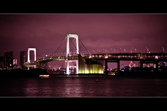 Horizontals: Rainbow bridge (manganite) Tags: bridge sunset sky panorama water colors japan architecture night clouds strand digital geotagged lights tokyo interestingness google rainbow nikon colorful asia purple nightshot tl dusk framed playa explore 日本 nippon 東京 odaiba d200 nikkor dslr minato nihon kanto tokyobay rainbowbridge avl interestingness390 i500 18200mmf3556 tokyobeach utatafeature manganite nikonstunninggallery geo:lat=35629535 geo:lon=139774332 date:year=2006 date:month=september date:day=11 format:orientation=landscape format:ratio=21