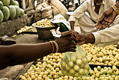 Done Deal (knowsnotmuch) Tags: hands market pavement pumpkins 100 lime bangles rupees 35mmf2 saidapet chennaiphotowalk