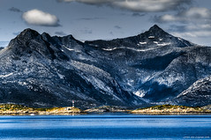 Mountains of Lofoten (Rob Orthen) Tags: blue sea summer sky lighthouse mountains norway clouds landscape nikon rocks europe august rob scandinavia polarizer lofoten meri maisema archipelago kes d300 norja saaristo 8020028 moodysky elokuu majakka orthen lofootit roborthenphotography norjansaaristo thelofots
