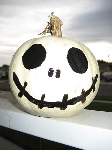 Just one white pumpkin, some black paint (next time I will use acrylic instead of latex- the next day his eye peeled off).