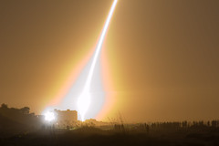 The space shuttle shuffle or Momentary daytime at night on the beach (jcgoforth) Tags: people beach night canon florida space nasa shuttle launch spaceshuttle bystanders lightroom cocoabeach endeavour sts126