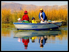 mariluz (maios) Tags: travel lake peru uros water reflections island greek boat photo women flickr photographer fotografia titikaka puno manikis maios iosif  heliography     mywinners           iosifmanikis