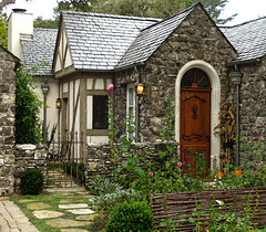 Once upon a time.... (linda yvonne) Tags: california haven stone cottage interestingness1 carmel hollyhocks irongate cottagegarden leavethelighton i500 litref storybookstyle storybookhomes lindayvonne withywattlefence whimsicalhomes