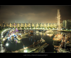 The Singapore Yacht Show at ONE15 Marina Club, Sentosa :: HDR (Artie | Photography :: I'm a lazy boy :)) Tags: reflection rooftop wet photoshop canon buildings boats lights construction singapore cityscape waterfront view tripod wideangle wharf sentosa ef 1740mm hdr artie cs3 lightings 3xp yatchclub f4l marinaclub photomatix tonemapping tonemap onedegree15 5dmarkii 5dm2 one15
