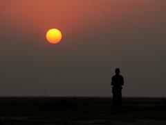 lone in sunset ... (Kamrul - Hasan) Tags: sunset sun man silhouette dawn bangladesh naturesfinest xti 400d canoneos400d kamrulhasan