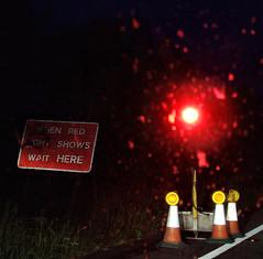 wait (allybeag) Tags: blur dark trafficlight roadworks wait redlight cones holdup