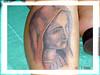 tatuagem santa na perna TARZIA TATTOO -