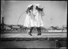 Girls skipping at an athletics carnival (Powerhouse Museum Collection) Tags: girls friends blackandwhite bw cute glass sisters children jumping twins play time duo victorian young plate games negative dresses innocence boardwalk summertime playtime nias skipping jumprope skippingrope plat powerhousemuseum publicdomain littlegirls skippinggirls bonnets welldressed showground jumpingrope woodensidewalk childrensgames xmlns:dc=httppurlorgdcelements11 dc:identifier=httpwwwpowerhousemuseumcomcollectiondatabaseirn319163 commons:event=commonground2009 saltandoalacuerda