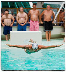 Before the Pain Strikes (Ryan Brenizer) Tags: wedding man love water pool fun nikon funny dive photojournalism july cruiseship 2008 d3 bellyflop 70200mmf28gvr stoppingtime michelleandtj