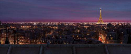 Fotograma de Ratatouille, de Disney Pixar en el que se ve a Remi sobre una azotea de París disfrutando de una panorámica con la Torre Eiffel al fondo